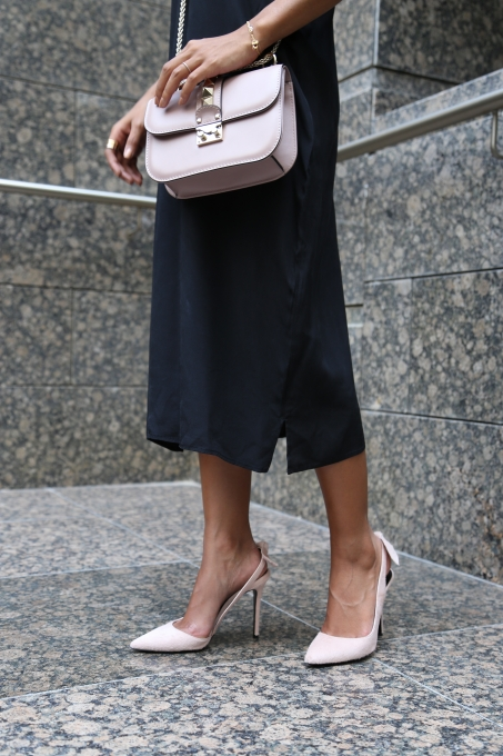Nadya Hasan with light pink Valentino bag from Selfridges
